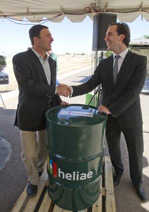 Heliae president and CEO Dan Simon (left) delivers the first barrel of Heliae-produced jet fuel to SkyNRG's Business Development Director, Maartin van Dijk.