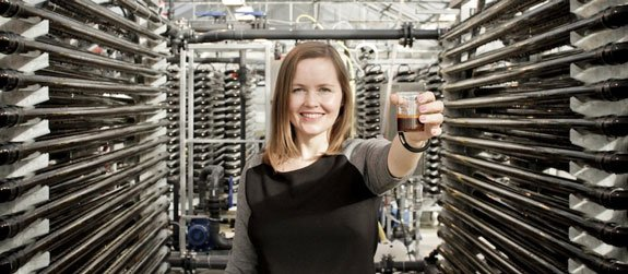 Fredrika Gullfot, founder and CEO of Simris Alg, displays their first algae oil production.