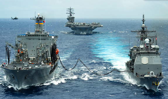 The Military Sealift Command fleet replenishment oiler USNS Henry J. Kaiser (T-AO 187), left, delivers a 50-50 blend of advanced biofuels and traditional petroleum-based fuel to the guided-missile cruiser USS Princeton (CG 59) during the Great Green Fleet demonstration portion of Rim of the Pacific (RIMPAC) 2012 exercise at Pearl Harbor, July 18, 2012.