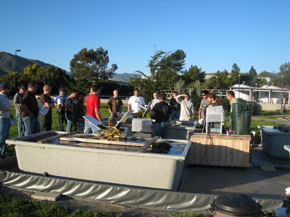 Students touring the Cal Poly algae research pond site.